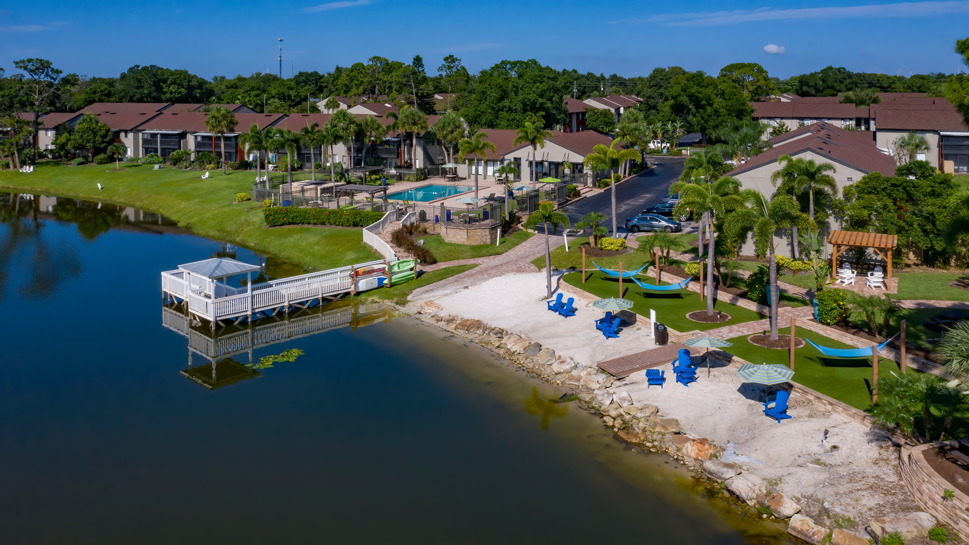 Aerial view of pool, beach and dock